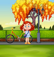 Little girl and bicycle in the park vector image