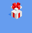 white giftbox with red ribbon on blue background vector image vector image