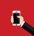 Hand holding white smartphone on red background vector image vector image