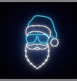 santa claus in a blue hat and sunglasses in neon vector image vector image