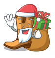 santa with gift leather cowboy boots shape cartoon vector image vector image