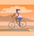 afro-american woman riding on bike mountain view vector image