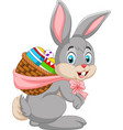 easter bunny carrying basket of easter egg vector image