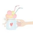 a male or female hand holds an ice cream in jar vector image