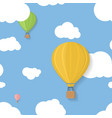 Three coloured aerostats in blue skies with clouds vector image