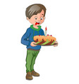 boy holding a cake with candle vector image
