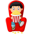 Cartoon boy watching movie in the cinema vector image