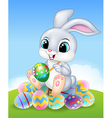 Cartoon Easter Bunny painting an egg on the easter vector image vector image
