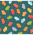 Seamless pattern with mittens and snow vector image