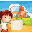 A kid in front of the school with an empty paper vector image