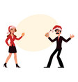 man woman in santa hats having fun at christmas vector image vector image