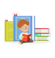 cute redhead boy reading a book next to a pile of vector image vector image