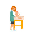 female pediatrician examines baby on scheduled vector image vector image