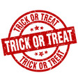 trick or treat round red grunge stamp vector image vector image