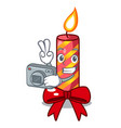 photographer christmas candle combined with pita vector image