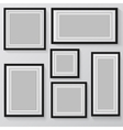 blank picture frame template set hanging on wall vector image