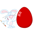 happy rabbit painting red easter egg vector image