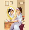 woman applying makeup vector image vector image