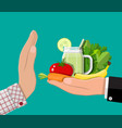 man refuses take healthy food with hand gesture vector image vector image