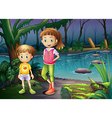 A boy and a girl standing in the middle of the vector image vector image