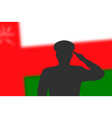 solder silhouette on blur background with oman vector image