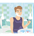 young man shaving in bathroom mirror vector image