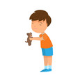 boy holding his brown puppy dog in hands vector image vector image