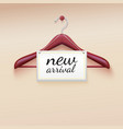Clothes hanger with new arrival tag vector image