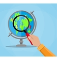 Globe with continents and magnifying glass vector image