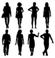 black silhouette group of people standing in vector image vector image