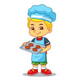 Boy baking chocolate cookies