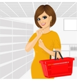 Thoughtful woman holding an empty shopping basket vector image vector image