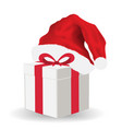 gift box with santa claus hat vector image vector image