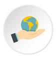 hand holding globe icon circle vector image