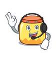 with headphone cream jar mascot cartoon vector image