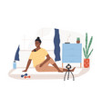 fitness blogger on yoga mat recording online video vector image vector image