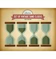 Set of vintage sand clocks on grungy card vector image