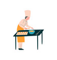 male cook cooking pastries on table professional vector image vector image
