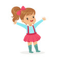 ute smiling little girl dressed in a pink skirt vector image