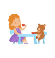 cute little girl playing with her teddy bear at vector image vector image