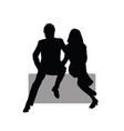 couple sitting on the rock silhouette vector image vector image