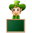 funny leprechaun cartoon with chalkboard sign vector image