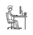 young man working on computer at office desk vector image