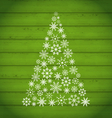 Christmas pine made of snowflakes on wooden vector image vector image