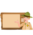 Ranger pointing at a wooden sign vector image vector image