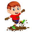 little boy enjoy playing in the mud vector image vector image