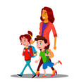 mother walking to school with children in new vector image