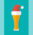 glass beer with a santa claus hat vector image vector image