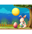 A bunny in the fence with two easter eggs vector image vector image