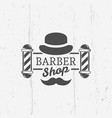 barber shop pole with gentleman hat emblem vector image vector image